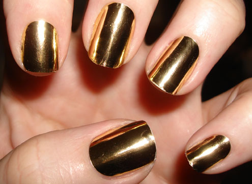 http://pamperedandpolished.co.uk/wp-content/uploads/2010/12/Nail-Rock-Gold.jpg